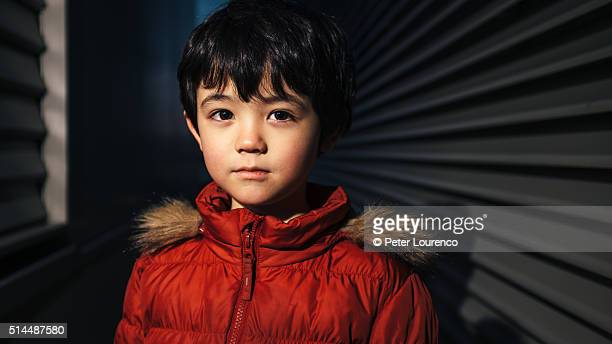 Portrait of a young boy in a dark space