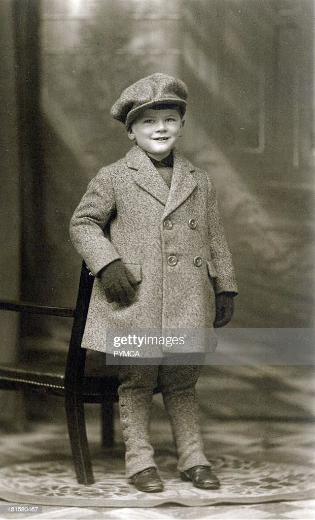 Portrait of a young boy in matching coat and hat circa 1900s