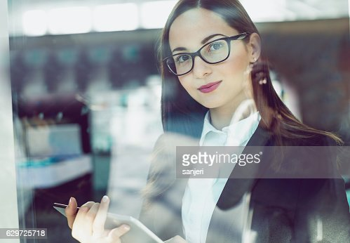 Portrait of a Young Buinesswoman Holding a Digital Tablet