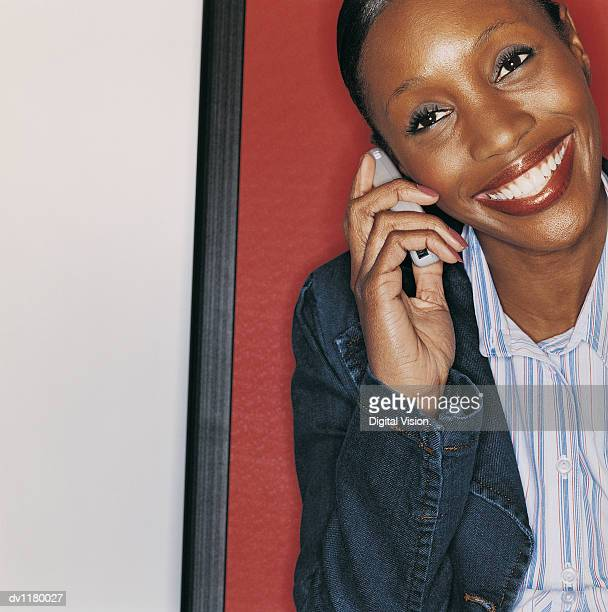 Portrait of a Young Businesswoman in Casual Clothing Using a Mobile Phone at a Business Conference