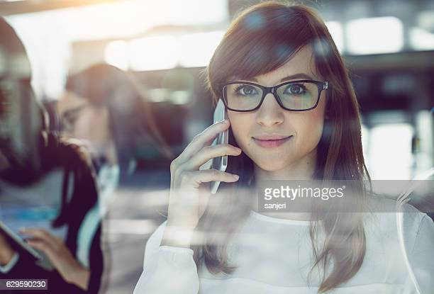 Portrait of a Young  Businesswoman Talking on Mobile Phone