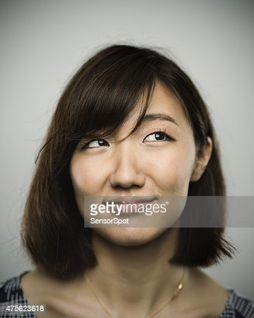 Portrait of a young chinese woman with happy smile