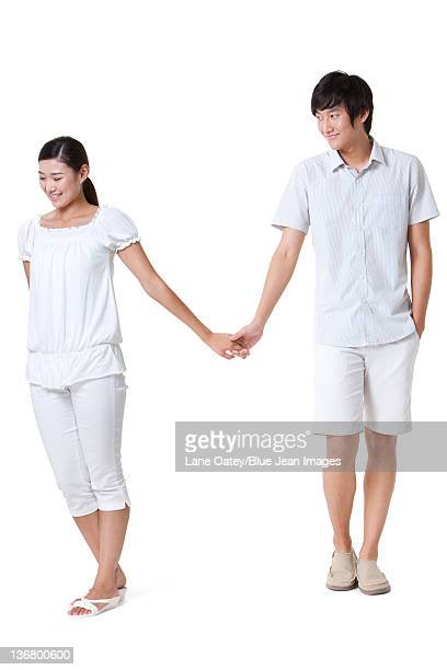 Portrait of a Young Couple Holding Hands