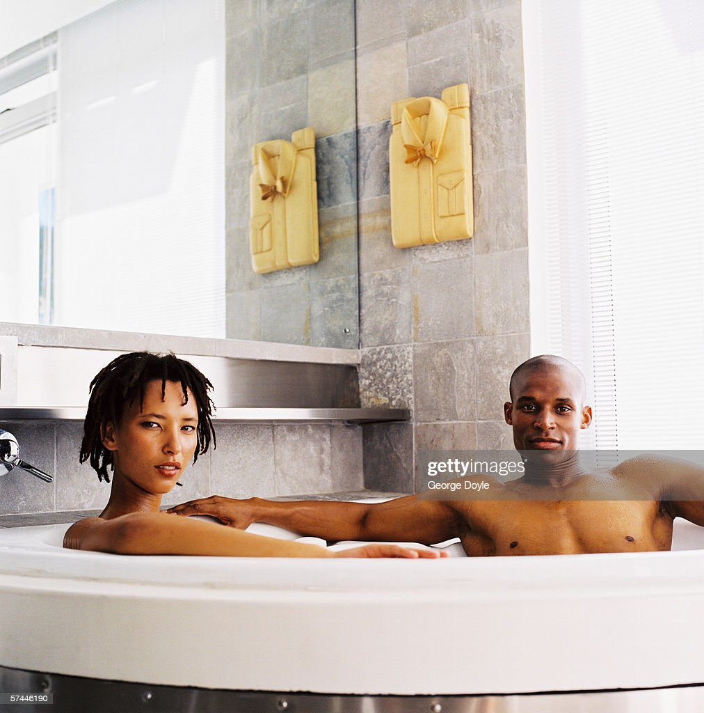 couples in a bath tub nake
