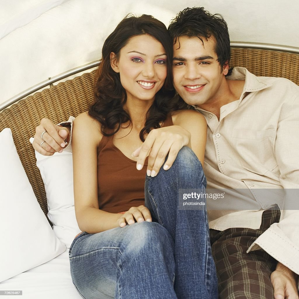 Portrait of a young couple on the bed