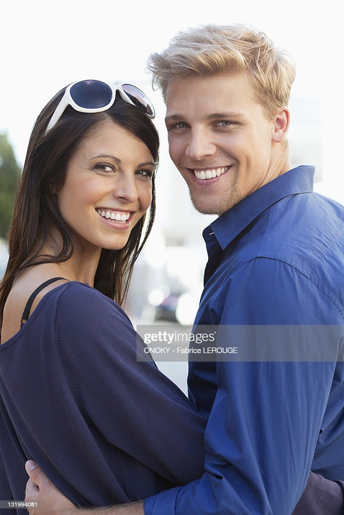 Portrait of a young couple smiling : Stock Photo
