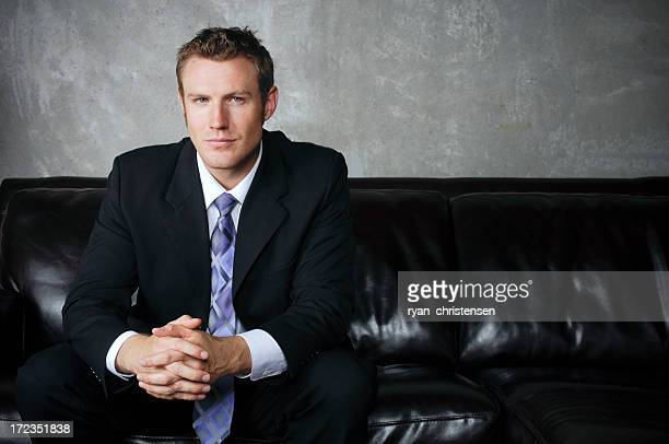 Portrait of a young executive sitting on sofa