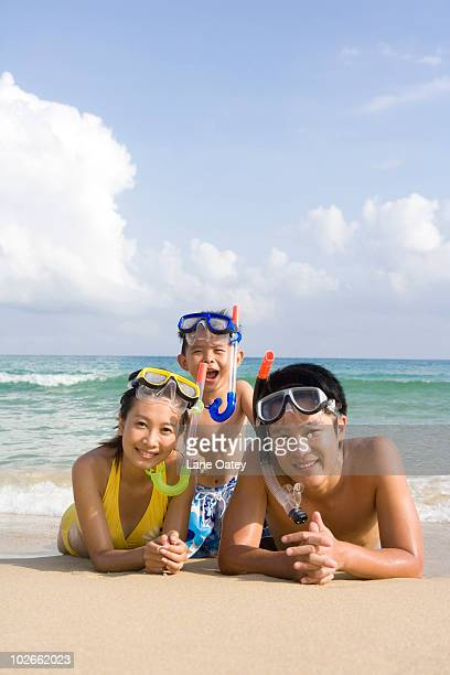 Portrait of a young family at the beach