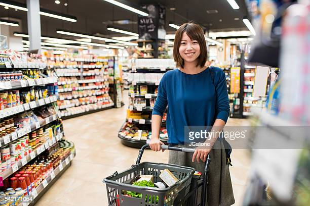 Portrait of a young female grocery shopping