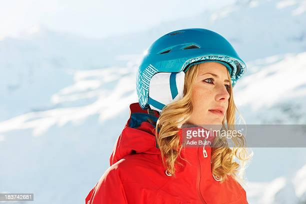Portrait of a young female snowboarder