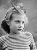 Portrait of a young girl aged 8 photographed in Leamington Spa circa 1945