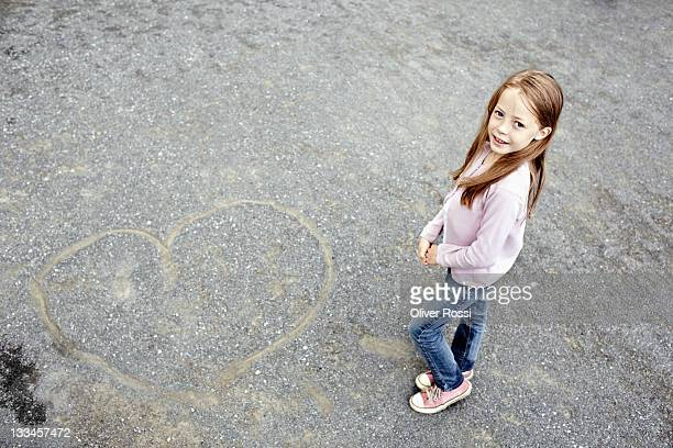 portrait of a young girl and a drawn heart