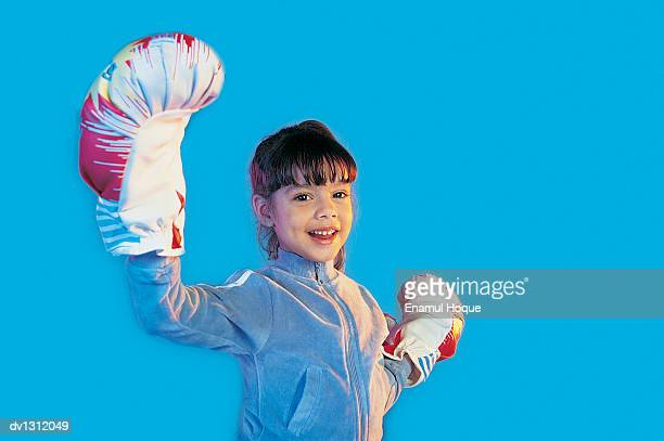 Portrait of a Young Girl Wearing Boxing Gloves