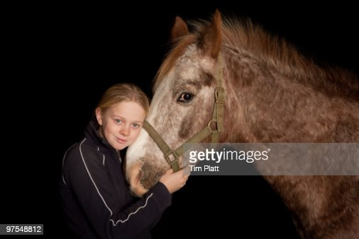 Portrait of a young girl with a horse. : Stock Photo