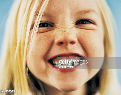 Portrait of a Young Girl With Gappy Teeth and Blond Hair