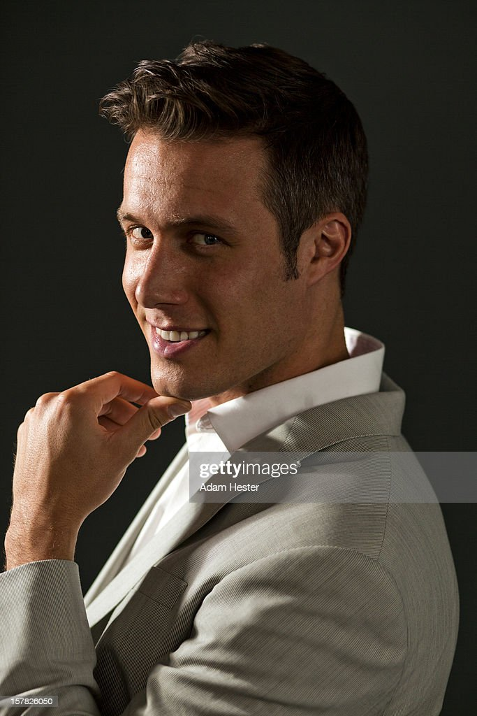 Portrait of a young good looking man in a studio. : Stock Photo