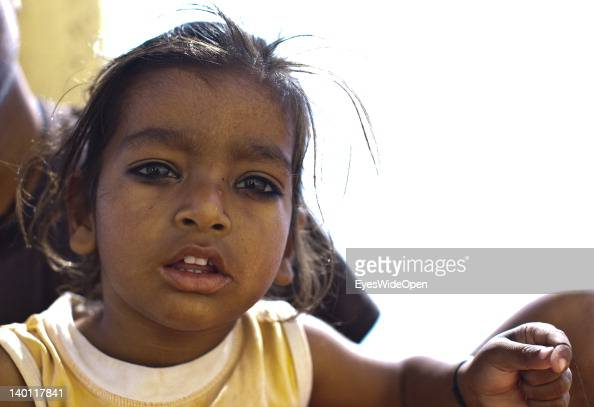 Portrait of a young indian girl with traditional black kajal makeup on her eyes for protection on February 1 2012 in the holy city of Varanasi Uttar...
