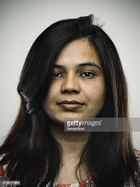 Portrait of a young indian woman looking at camera