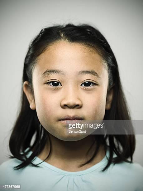 Porträt eines jungen japanischen Mädchen Blick in die Kamera.