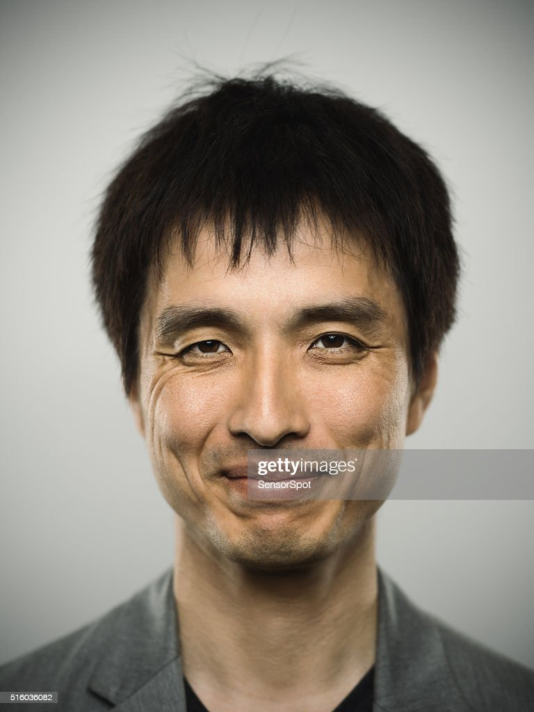 Portrait of a young japanese man looking at camera : Stock Photo