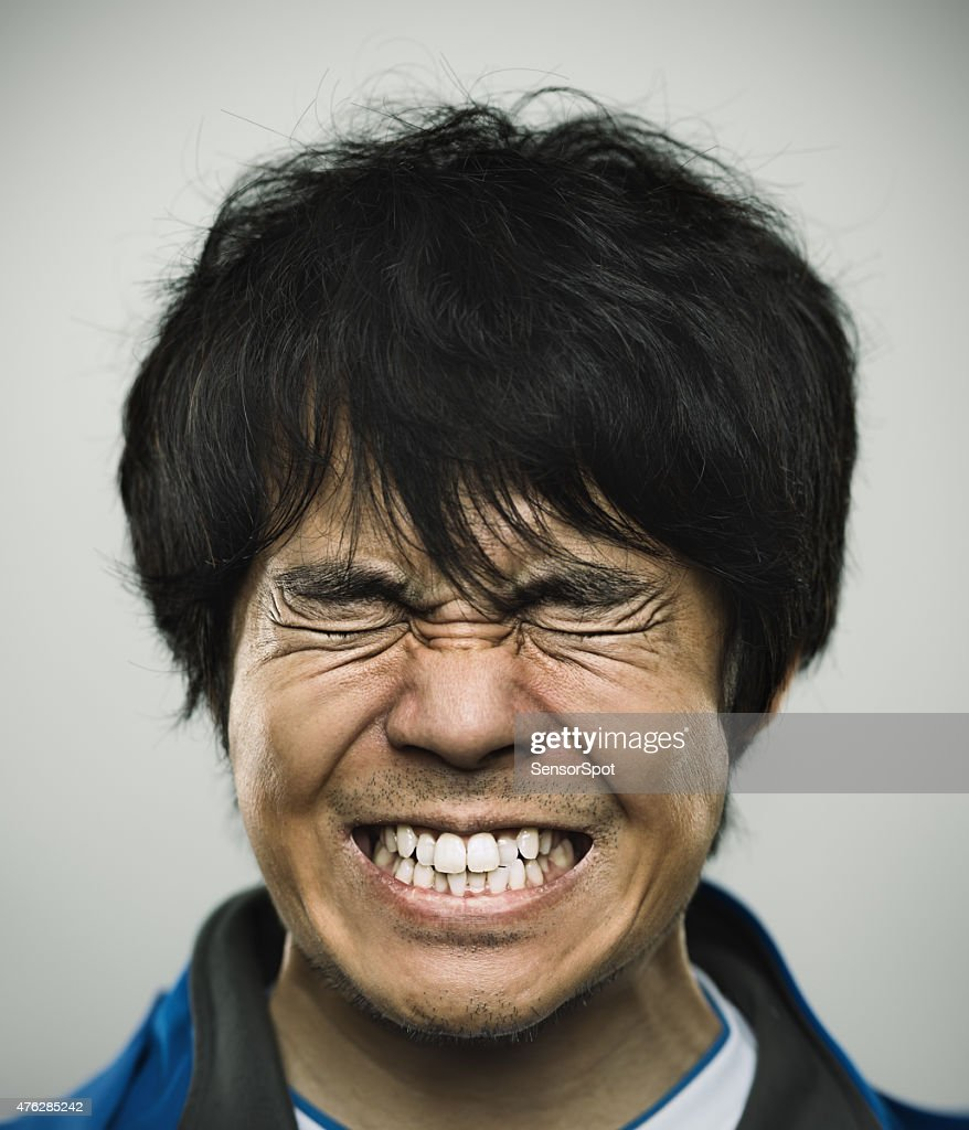 Portrait of a young japanese man under stress : Stock Photo
