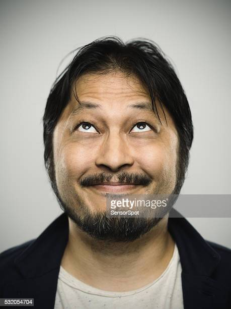 Portrait of a young japanese man with happy expression