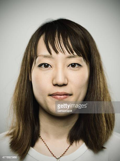 Portrait of a young japanese woman looking at camera