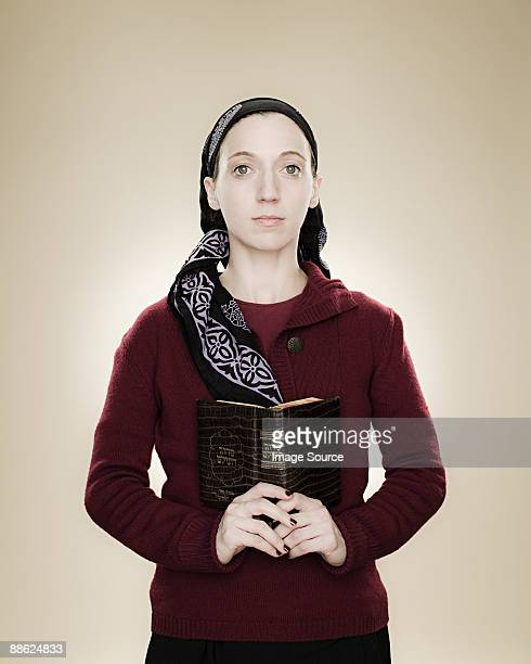 Portrait of a young jewish woman holding a prayer book