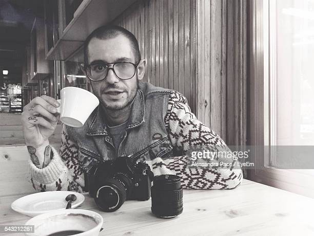 Portrait Of A Young Man Drinking Tea