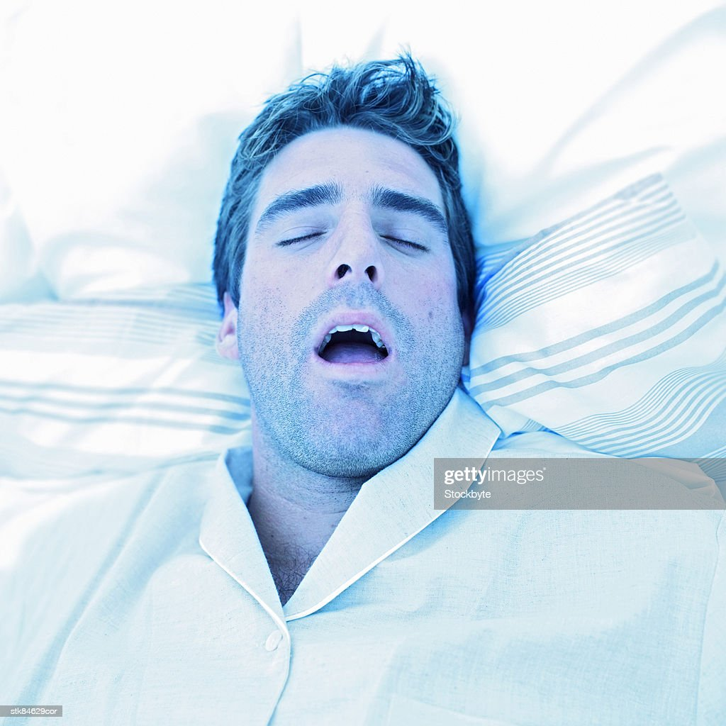 portrait of a young man fast asleep : Stock Photo