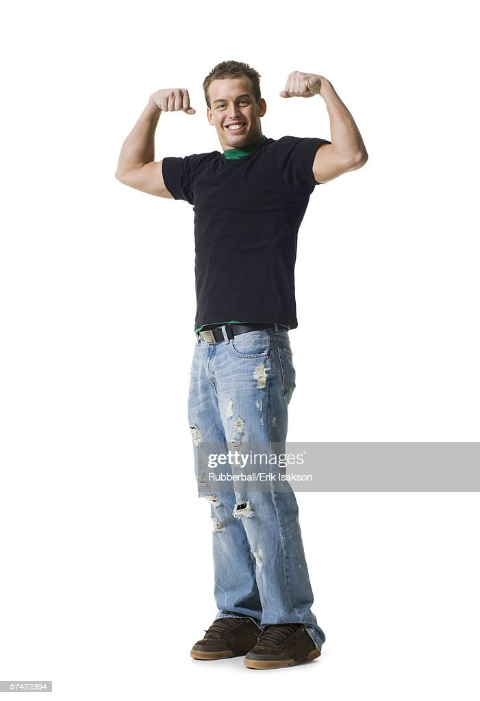 Portrait of a young man flexing muscles : Stock Photo