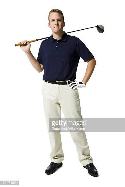 Portrait of a young man holding a golf club