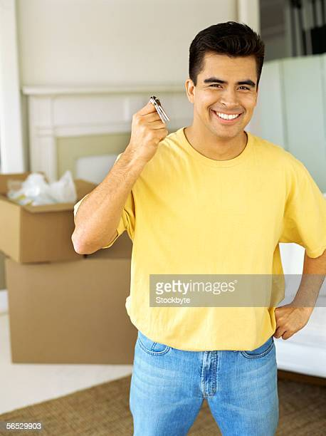 portrait of a young man holding house keys