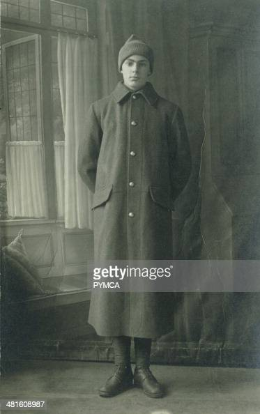 Portrait of a young man in a long overcoat circa 1930s