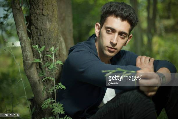 Portrait of a young man in between nature.