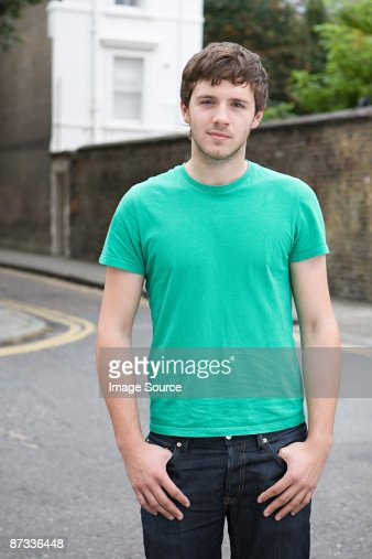 Portrait of a young man in street