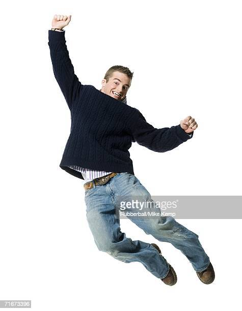 Portrait of a young man jumping in mid air