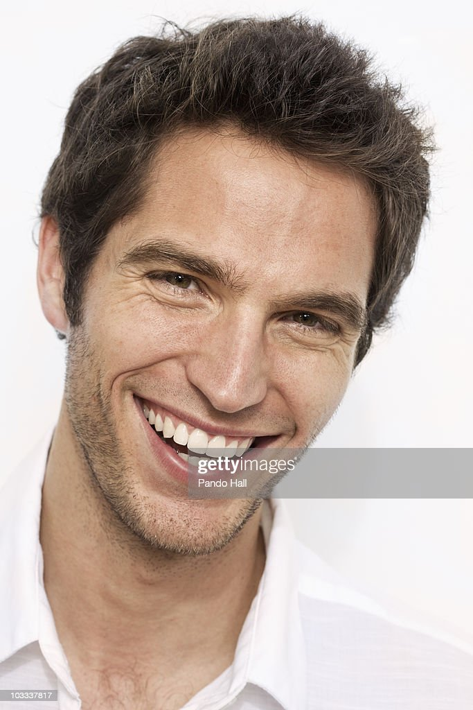 Portrait of a young man laughing, close-up : Stock Photo