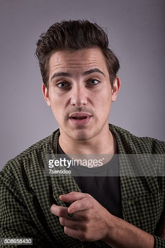 Portrait of a young man looking at the camera European : Stock Photo