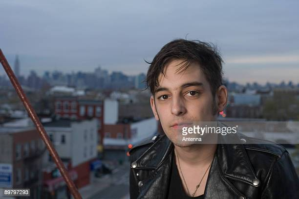 Portrait of a young man on a fire escape