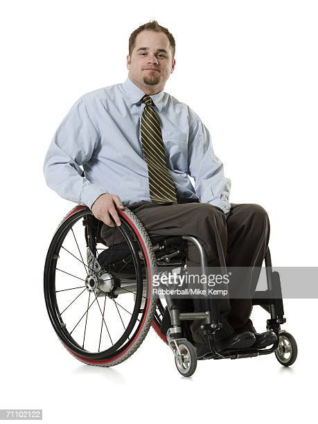 Portrait of a young man sitting in a wheelchair