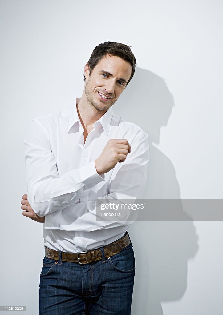 Portrait of a young man smiling : Stock Photo