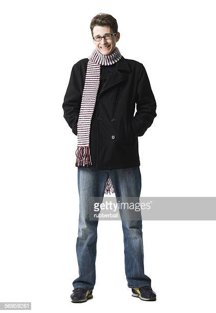 Portrait of a young man standing with his hands in his pockets