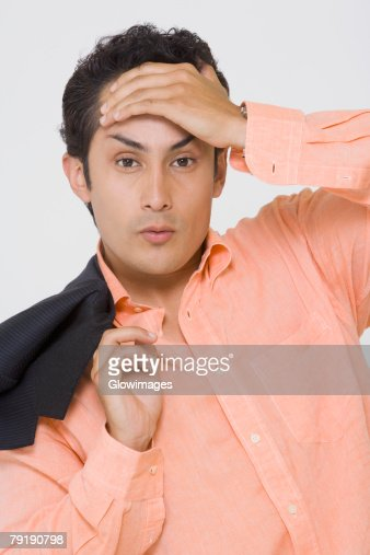 Portrait of a young man suffering from a headache : Stock Photo