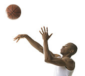 Portrait of a young man throwing a basketball