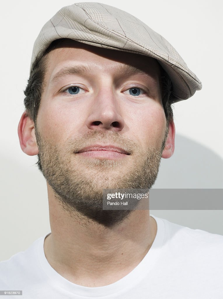 Portrait of a young man wearing hat, close-up