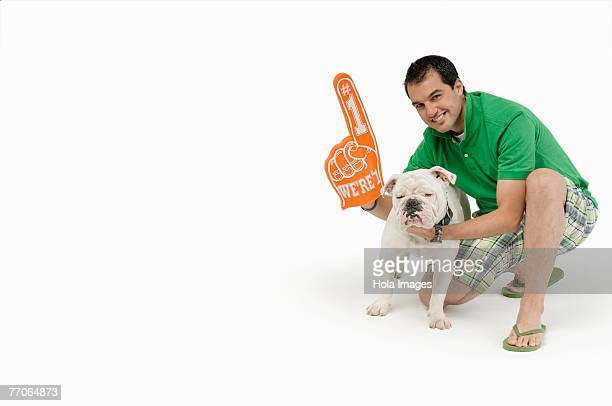 Portrait of a young man with a Bulldog and smiling