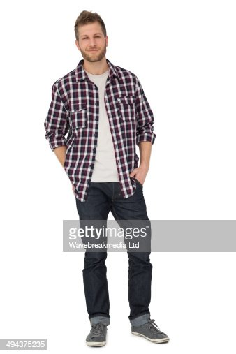 Portrait of a young man with hands in pockets : Foto de stock