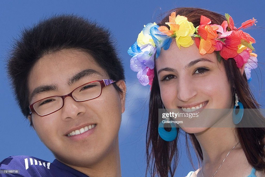 Portrait of a young man with his friend smiling : Stock Photo
