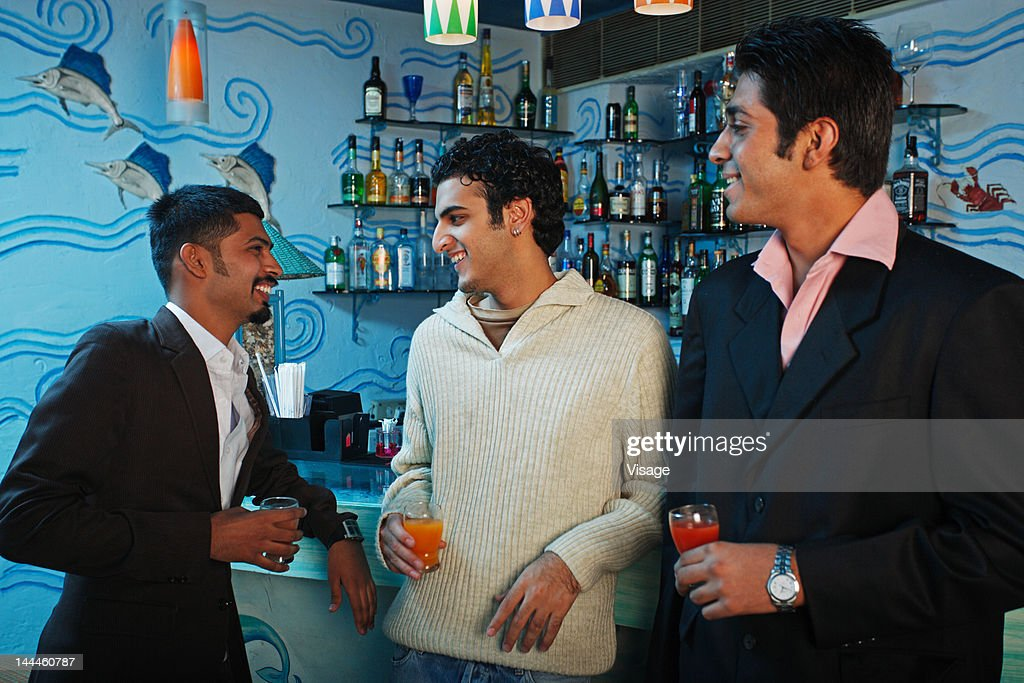 Portrait of a young men in a bar : Stock Photo